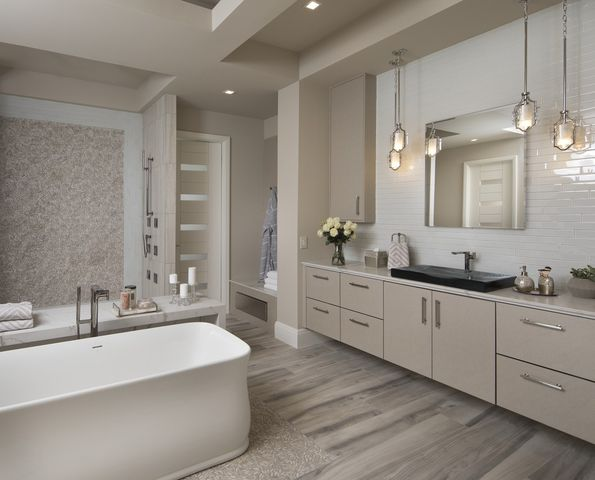 The master bath in the New American Home has a freestanding tub and walk-in shower.