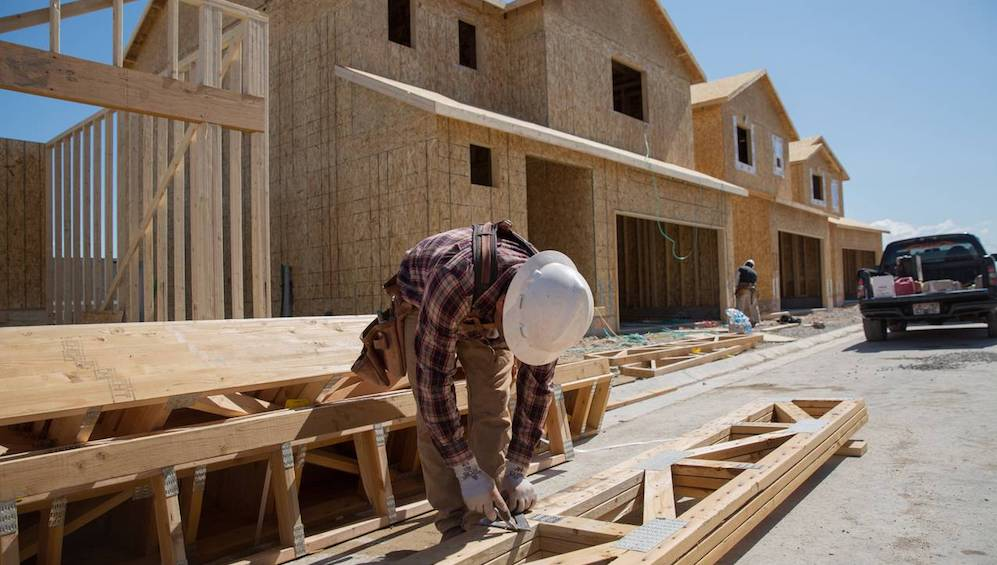 Construction workers frame a new home at a Woodside Homes site in Saratoga Springs, Utah, in May 2017. Utah is among the 22 states that built too little housing in the 15 years since 2000.