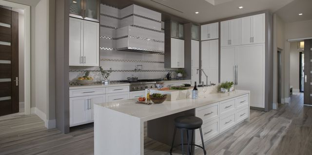 The kitchen in the New American Home features built-in conveniences, such as a coffee maker.