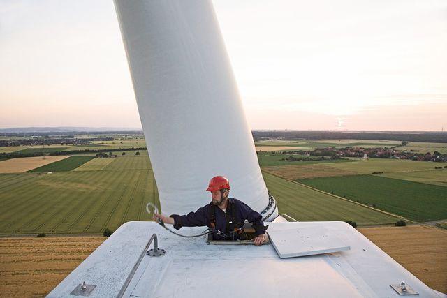 Maintenance worker on wind power station